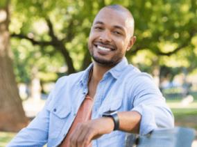 man-smiling-outside